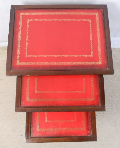 Nest of Three Mahogany Coffee Tables with Red Leather Tops